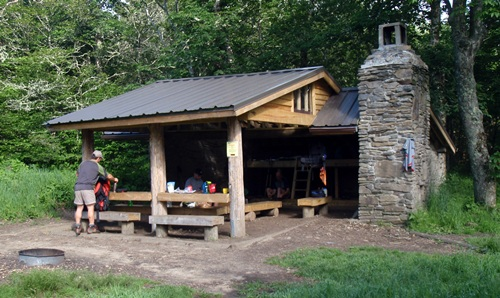 Double Spring Gap Shelter sits right on the Appalachian Trail with a grassy area in front. Great Smoky Mountains National Park