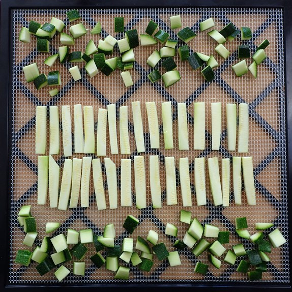 Zucchini noodles and skins on dehydrator tray.