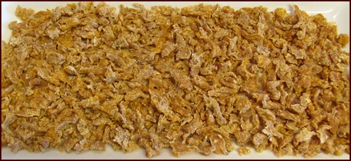 Dehydrated pressure cooked chicken. Use in meals or eat it dry as crunchy chicken jerky.