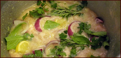 Aromatic ingredients in the pressure cooker with the chicken and potato-thickened liquid.