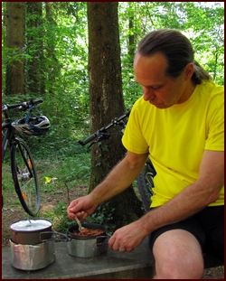 Chef Glenn McAllister cooking a backpacking meal.