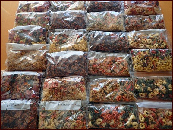 Dehydrated backpacking meals ready for the final step in dehydrated food storage: vacuum sealing.