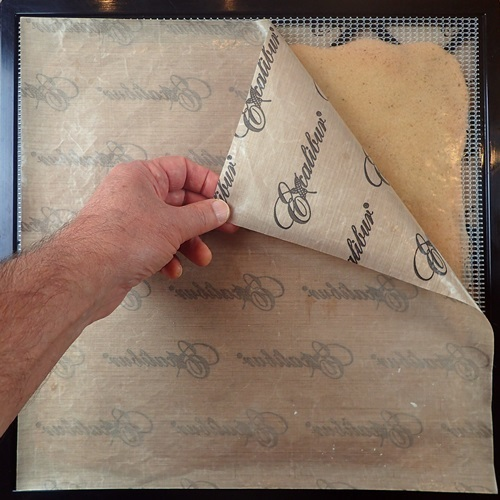 Flip trick: Peeling away the nonstick sheet from fruit leather after flipping it over.