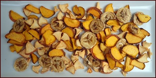 Dried peaches make a colorful addition to fruit cocktail. Shown with dried bananas and apples.