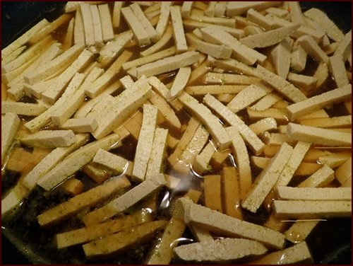 Tofu cut into noodle shapes, lightly seasoned and cooked in liquid before dehydrating.