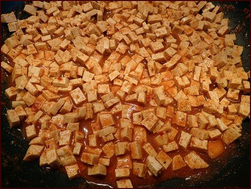 Tofu cut into small squares, seasoned with taco flavors.