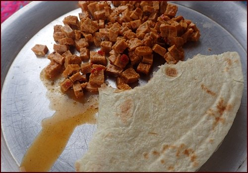 Square cut, taco-flavored dried tofu after rehydration. Enough for two tortillas.
