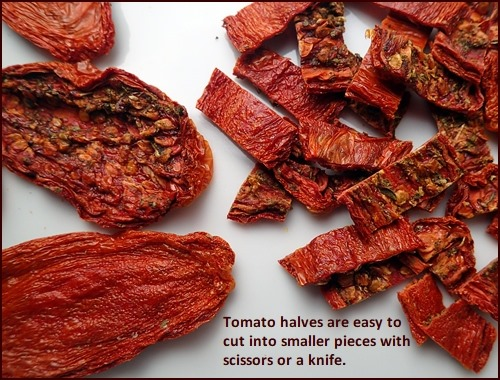 Dehydrated tomato jerky on left, cut into smaller pieced on right.