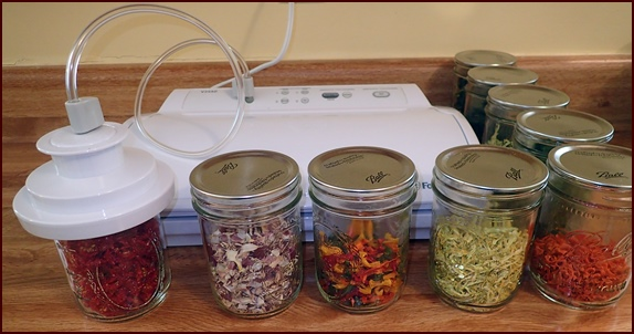 Storing dehydrated vegetables in jars with FoodSaver wide-mouth jar sealer.